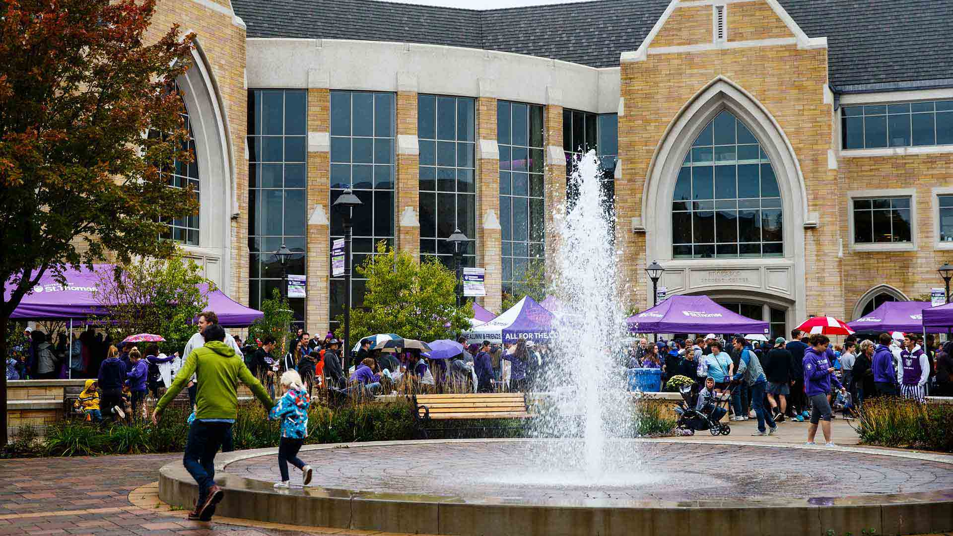 Guests outside during a homecoming Purple on the Plaza.