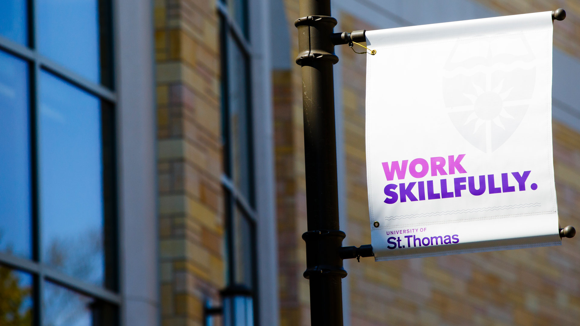 University of St. Thomas branded banner with text on it that says the following Work Skillfully.