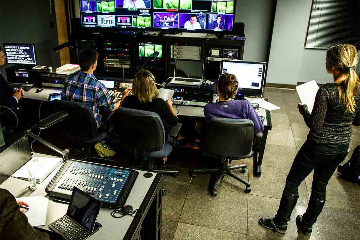 "Journalism students work in the control room during production of the TommieMedia program ""The Locker Room"" in the TV studio."
