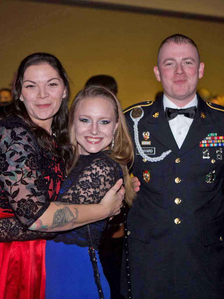 Veteran family smiling and posing at the annual Veterans Ball.