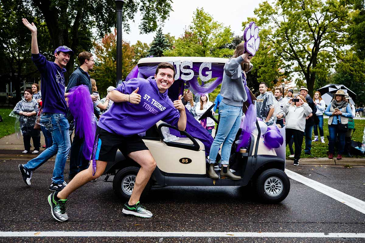 Student government members march in the homecoming parade.