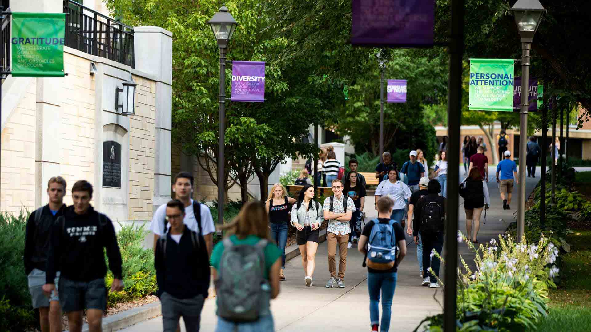 Students walk from the upper quad to the lower quad.