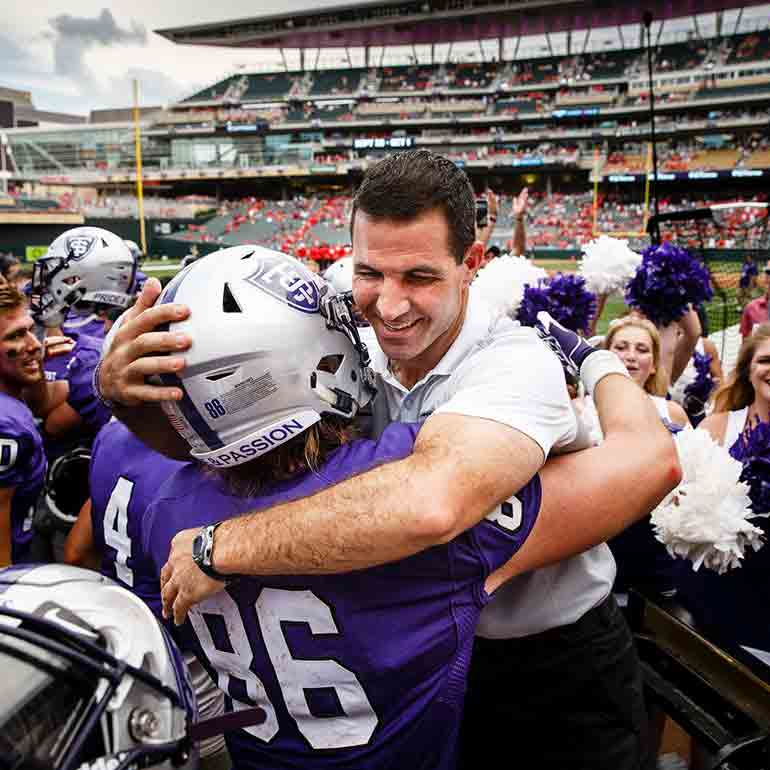 Coach Glenn Caruso  at the end of the Tommie Johnnie football game.