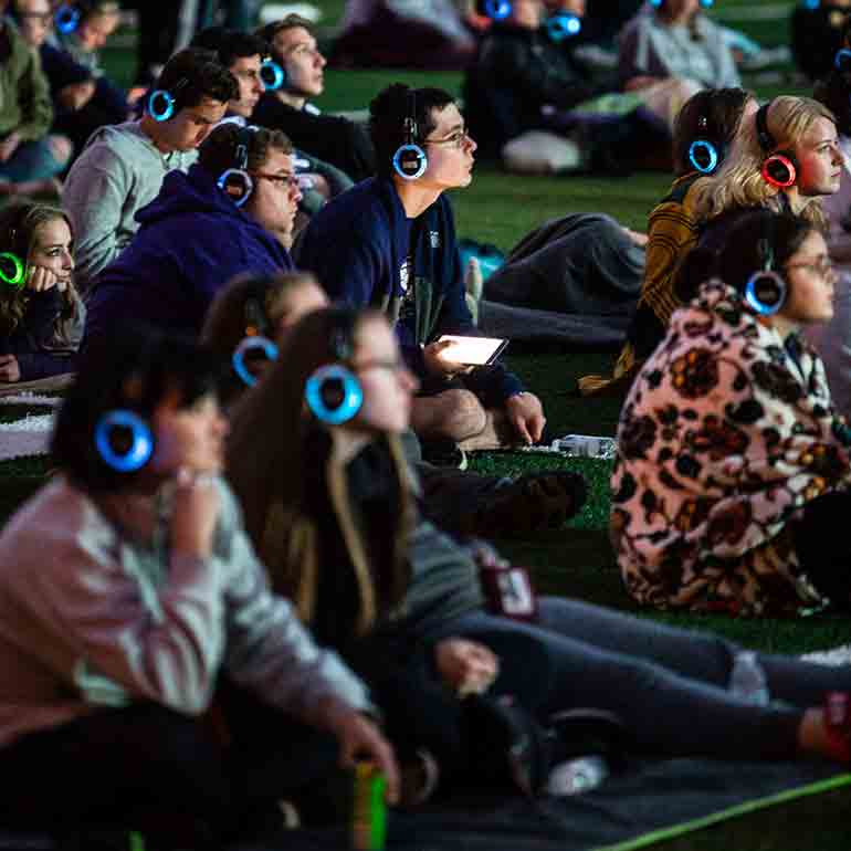 Students attend a movie screening on Palmer Field in O'Shaughnessy Stadium.