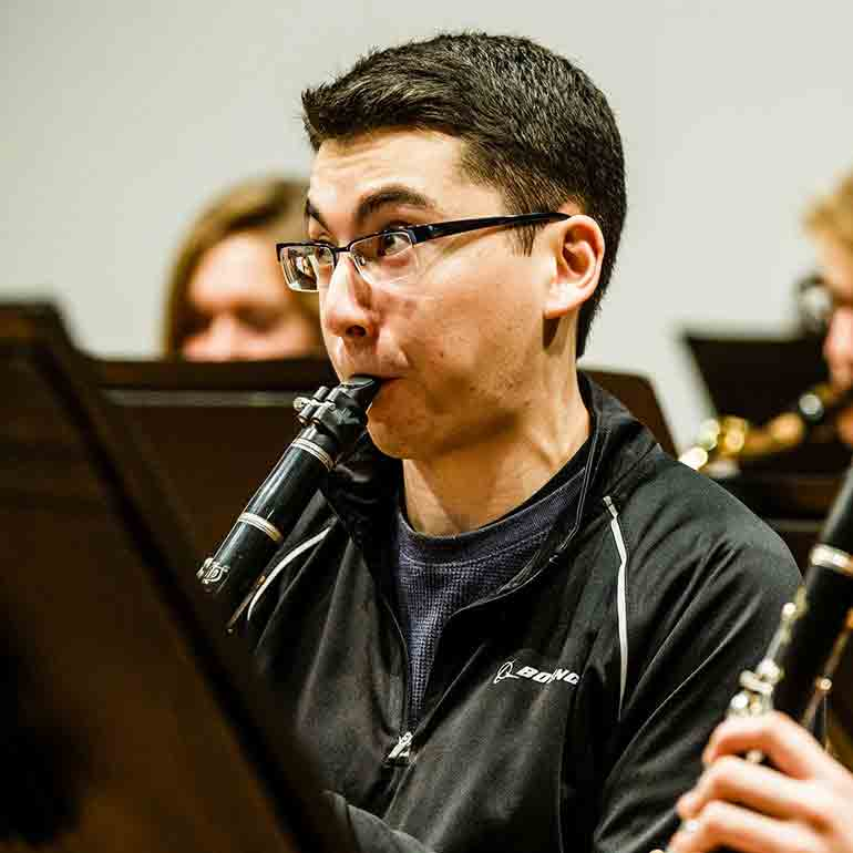 Student plays clarinet during a wind ensemble practice.