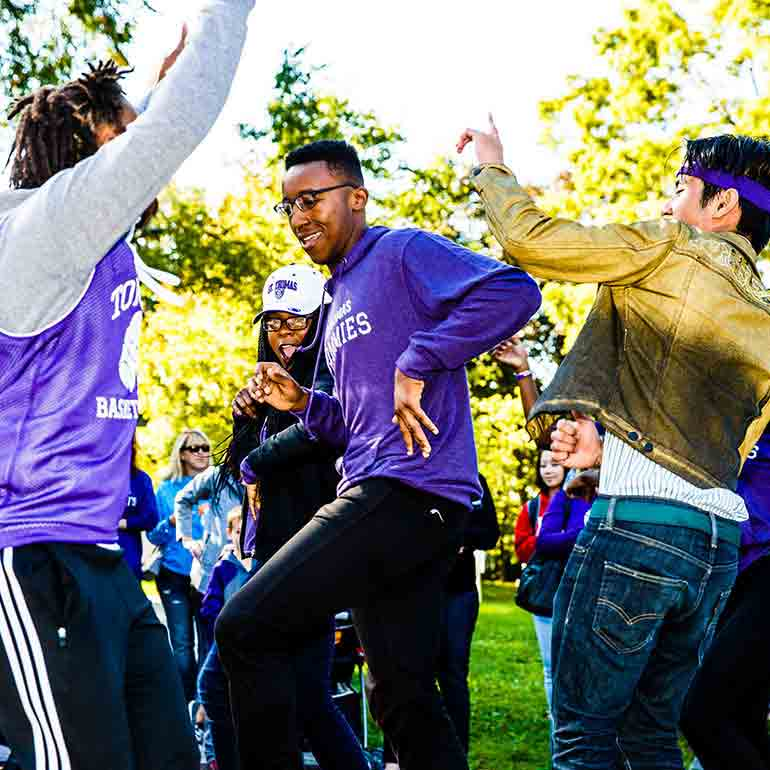 Students dance and perform in the homecoming parade.