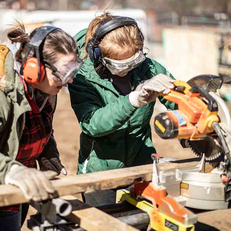 Students volunteer on a Habitat for Humanity Women Build house project