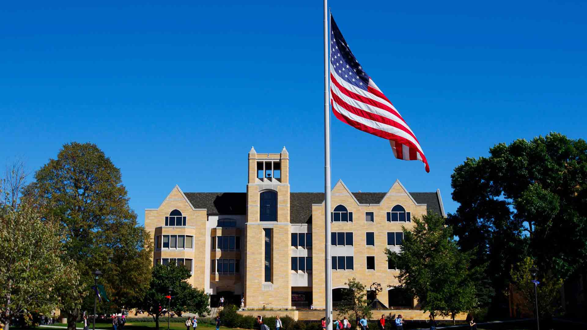 The American flag is prominent in front of the O'Shaughnessy Library on North Campus.